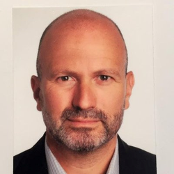 Photo of Joerg Koesters, who writes that small and midsize retailers must set a digital foundation for every aspect of their business to remain competitive